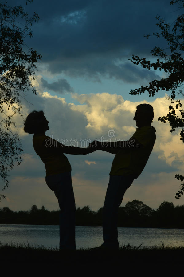 Silhouette of an elderly couple stock photography