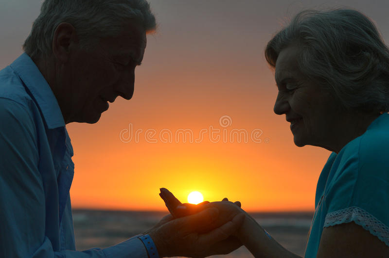 Silhouette of an elderly couple stock photos