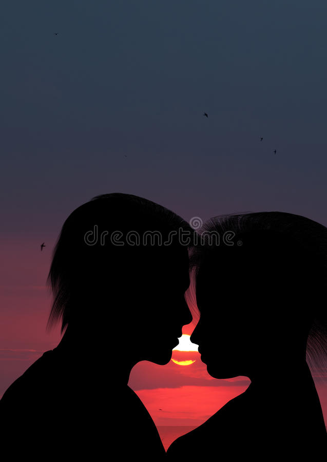 Silhouette embrassant un couple affectueux photo stock