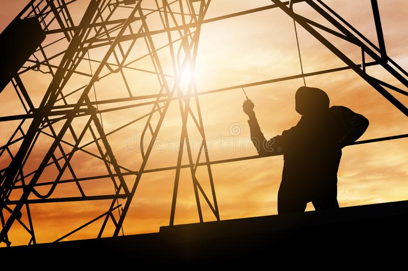 Silhouette engineer holding radio and ordering at construction working site.  stock images