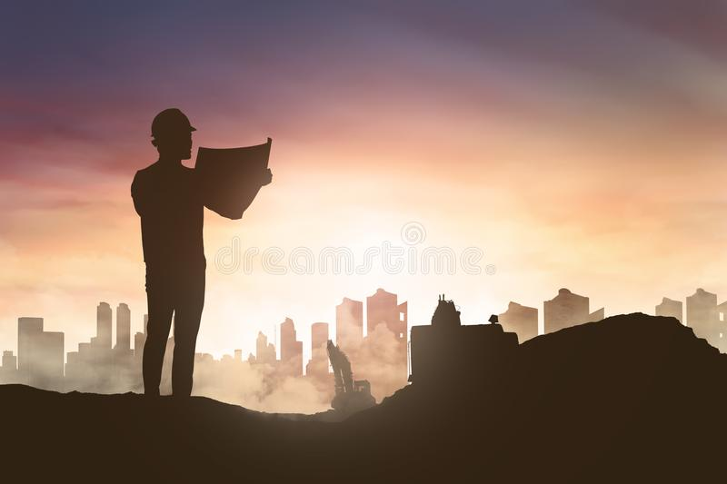Silhouette of engineer man looking his blueprint in construction stock illustration