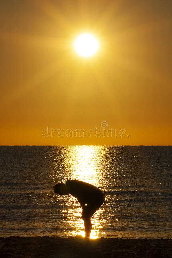 Silhouette Exhausted Man Resting Sea Sun Profile royalty free stock photography
