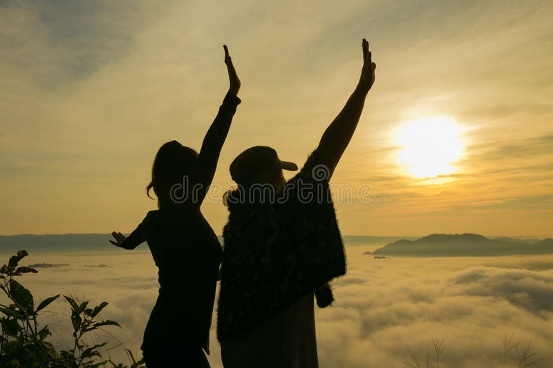 Silhouette The expression of freedom of the two women. The expression of freedom of the two women with mist royalty free stock photos