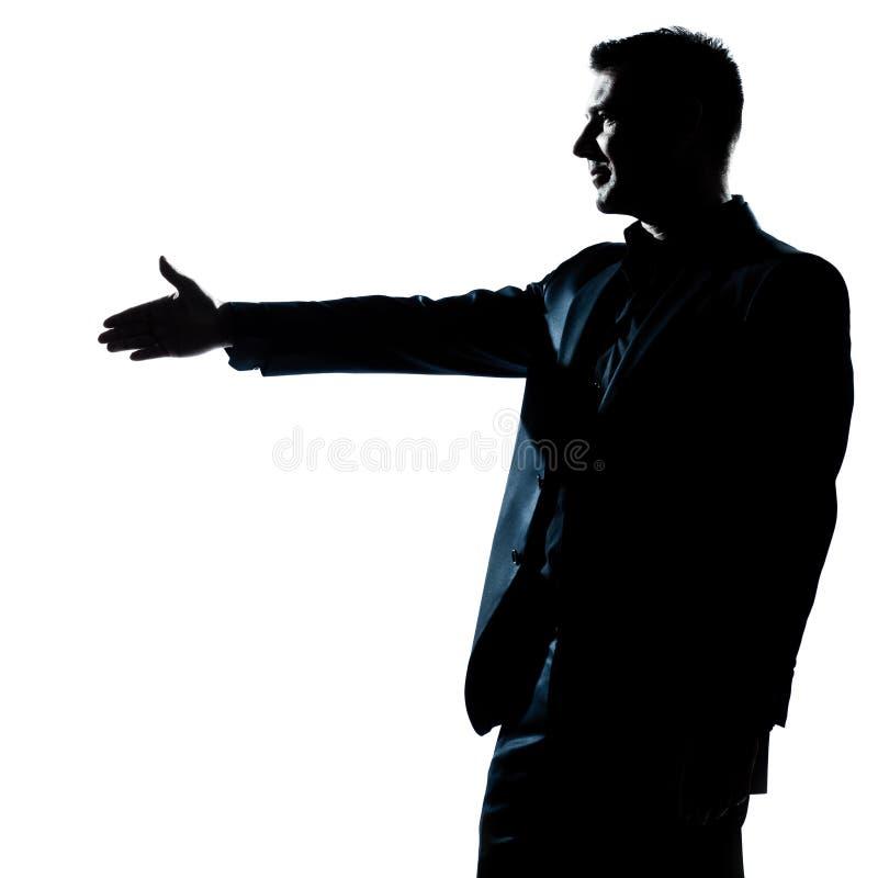 silhouette för profil för handskakningmanstående arkivfoton