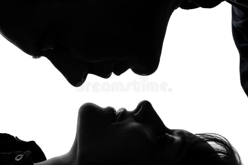 Silhouette face à face d'homme de femme de couples photo stock