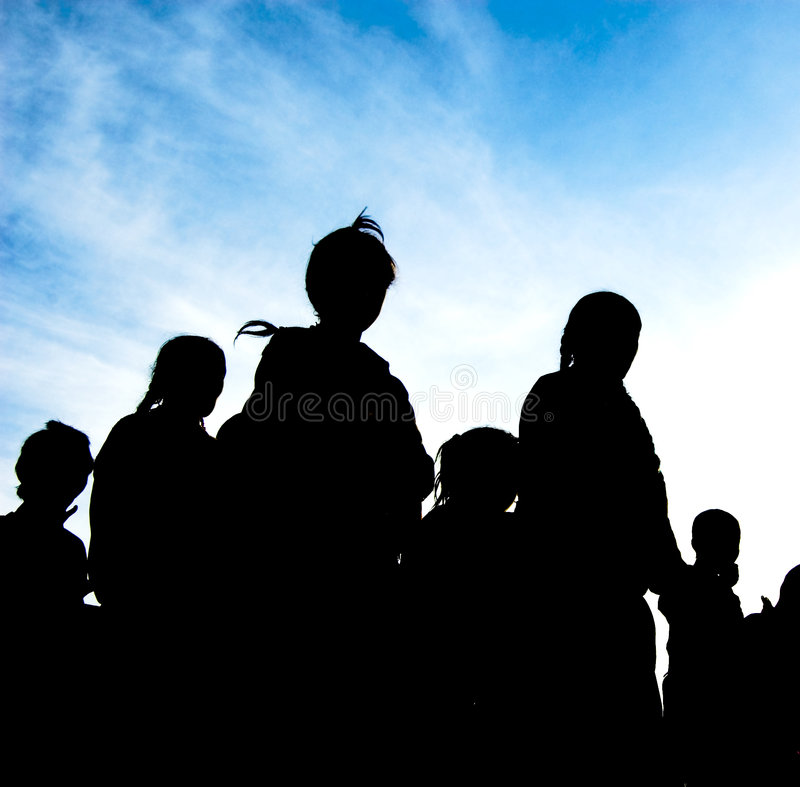 Silhouette of family. Walking under the blue sky stock image