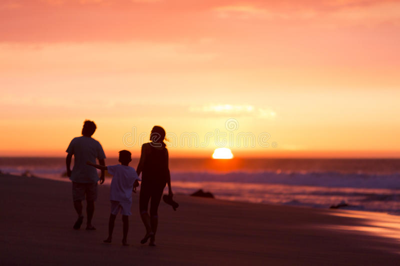 Silhouette of family on the beach at dusk in Peru royalty free stock images