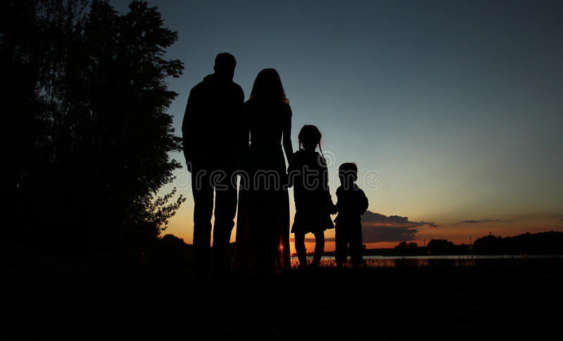Silhouette of a family with children. Silhouette of a happy family with children stock image