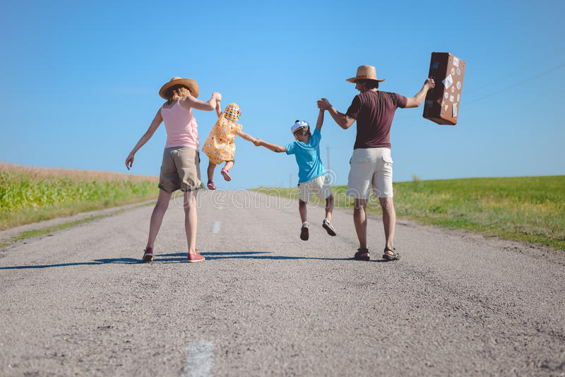 Silhouette of family joyful walking on the. Picture silhouette of family joyful walking on the countryside rural road on sunny blue sky outdoors background royalty free stock image