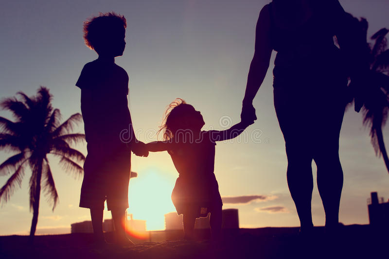 Download Silhouette Of Family With Kids Play At Sunset Beach Stock Image - Image of retired, generations: 86281207