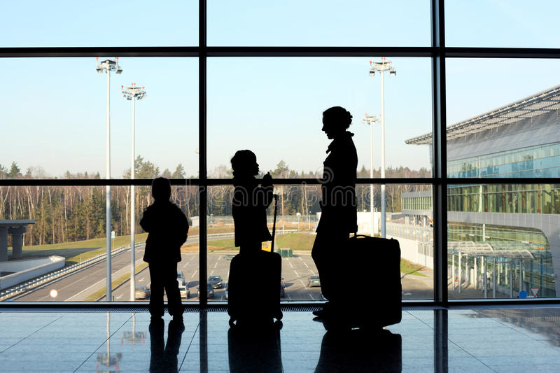 Silhouette of family with luggage royalty free stock image