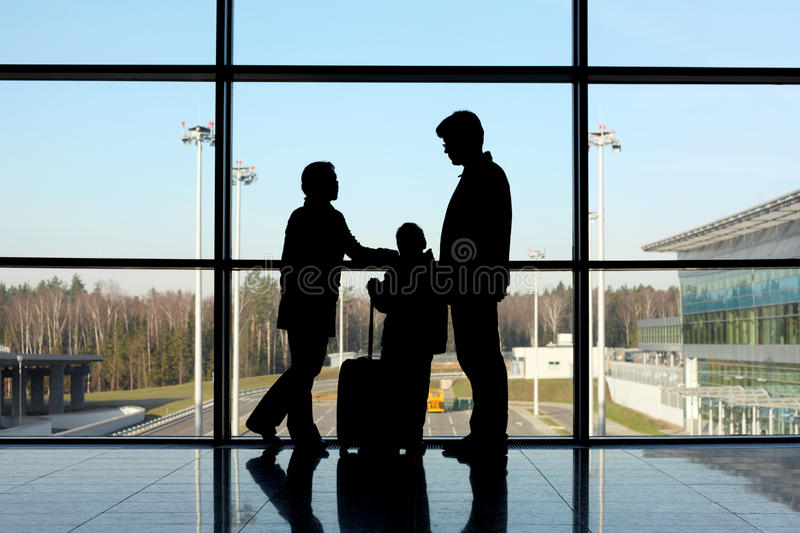Download Silhouette Of Family With Luggage Near Window Stock Photo - Image: 15521890