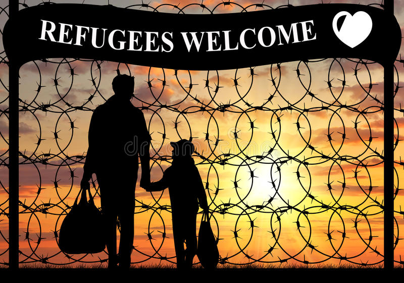 Silhouette of a family refugee. Concept of refugee. Silhouette of a family with a child refugee father near the fence with barbed wire and the inscription stock images