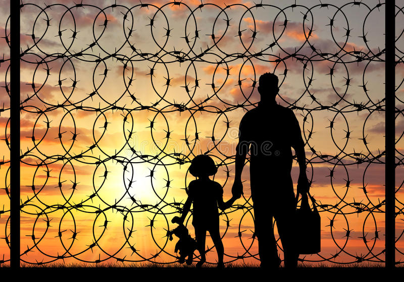 Silhouette of a family refugee. Concept of refugee. Silhouette of a family with a child refugee father near the fence with barbed wire at sunset stock photography