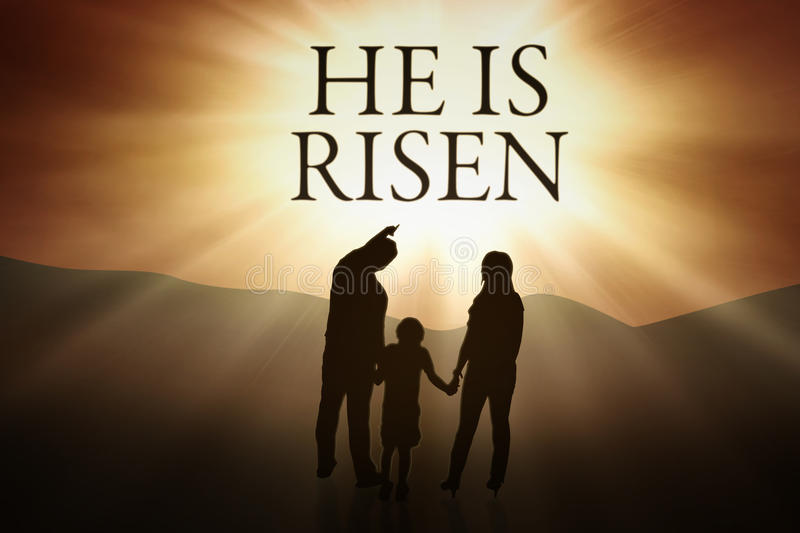 Silhouette of family and text He is risen. Silhouette of Christian family holding hands together while looking at text He is risen. Easter concept stock photo