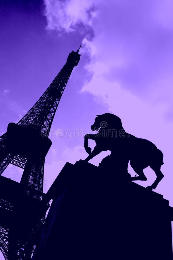 Silhouette of Eiffel Tower with Horse Statue. Silhouette of the famous Eiffel Tower located in Paris, France; including a horse sculpture that in the foreground stock photography