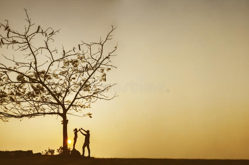 Silhouette of father and child at sunset time royalty free stock photography