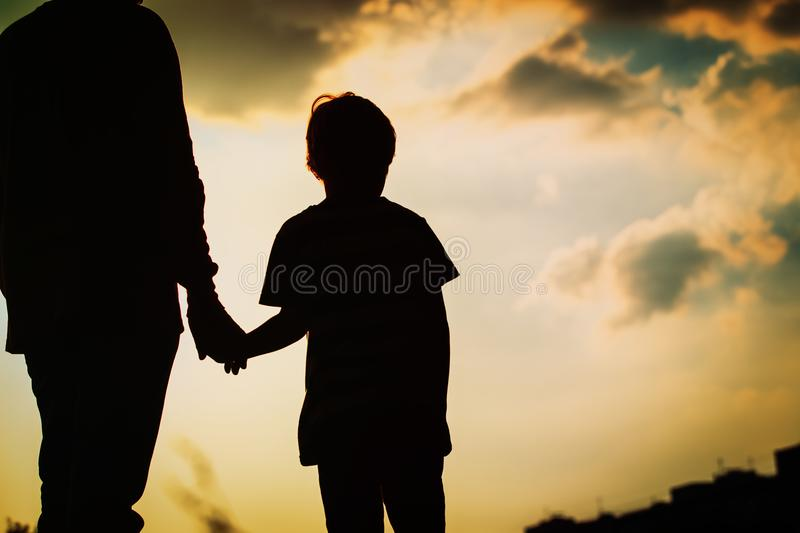 Download Silhouette Of Father And Son Holding Hands At Sunset Stock Image - Image of back, silhouette: 114288625