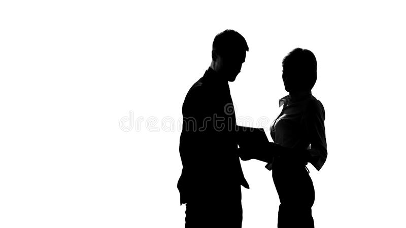 Silhouette of female director discussing business plan with manager in office. Stock photo stock images