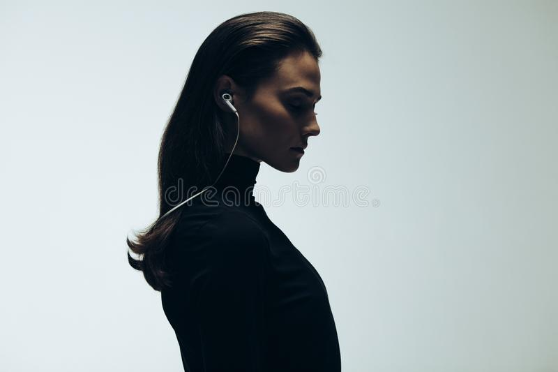 Silhouette of female model in studio royalty free stock image