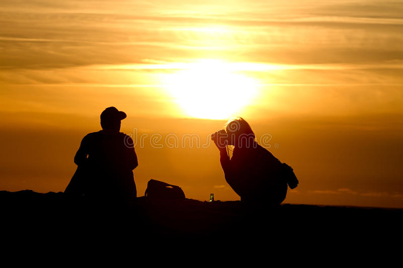 Download Silhouette Of Female Photographer At Sunset Stock Photo - Image: 21238308