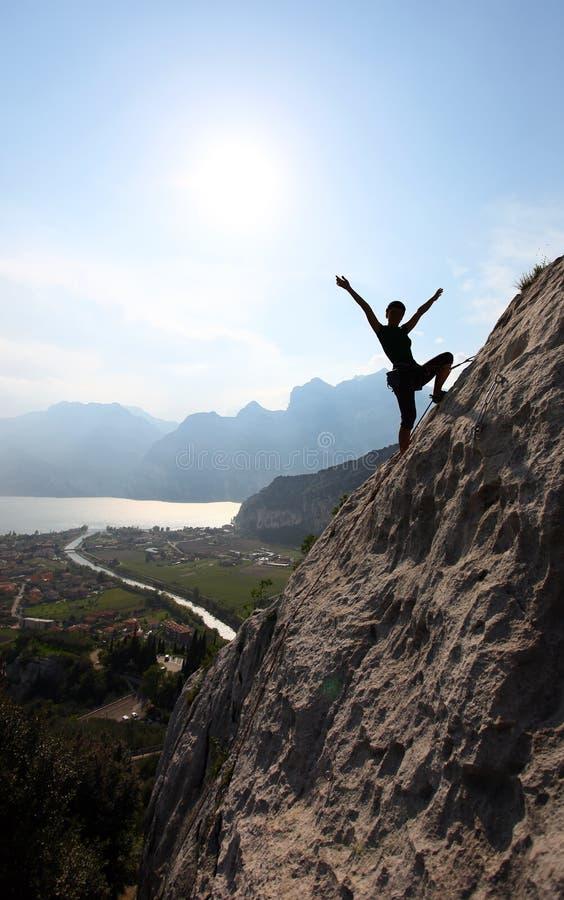 Silhouette of a female rock climber