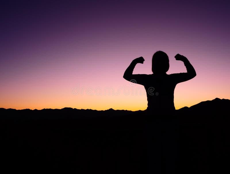 Silhouette femelle de force photos libres de droits