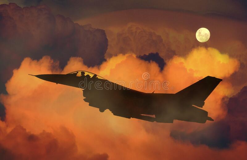 Silhouette of Fighter Plane Flying Through Clouds royalty free stock image