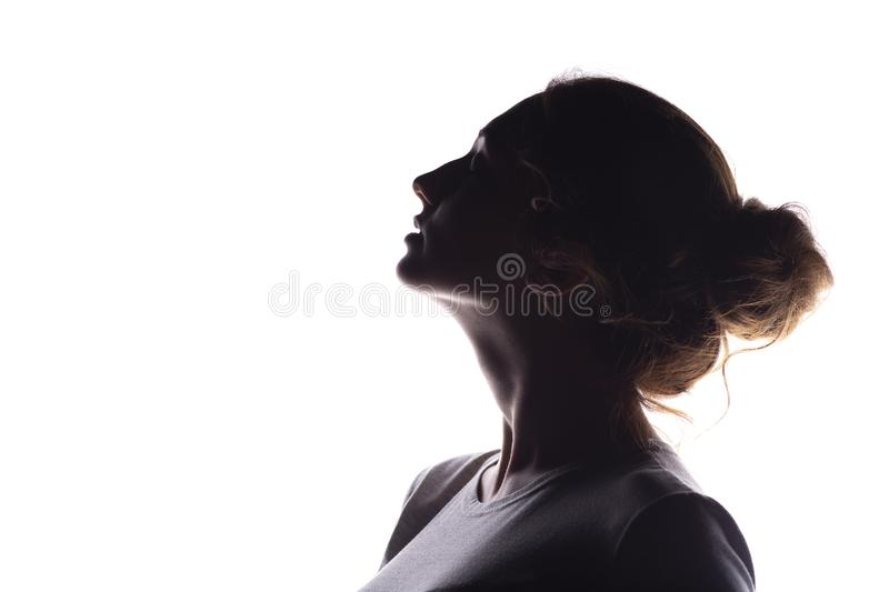 Silhouette of figure of beautiful girl, woman profile on white isolated background, concept of beauty and fashion royalty free stock photography