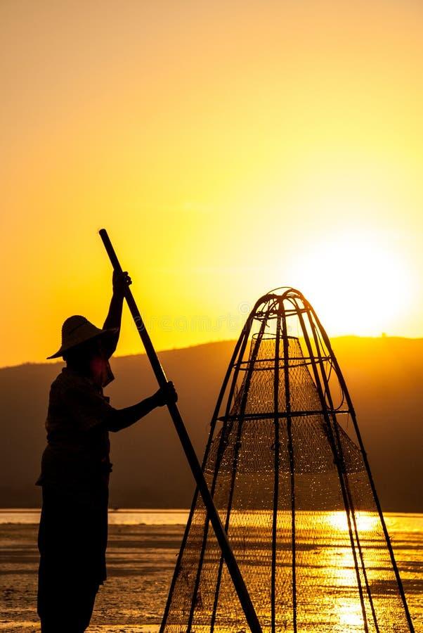Silhouette fisherman at Inle Lake, Myanmar stock photo
