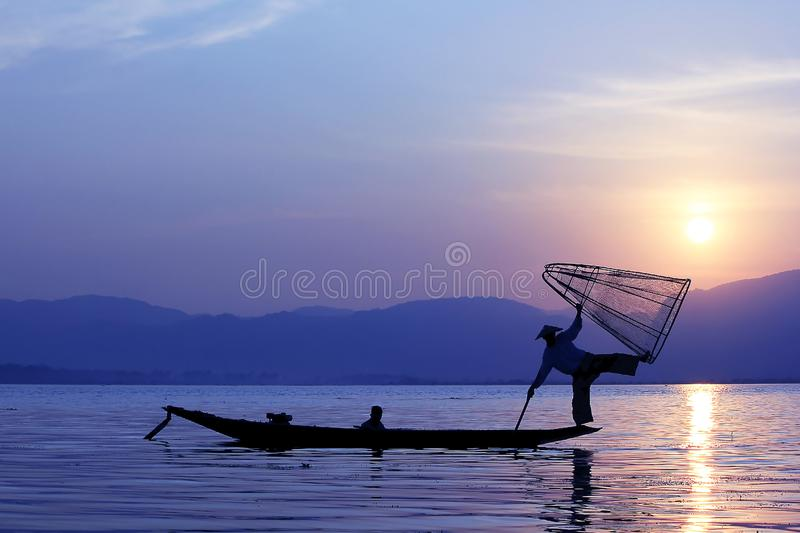 The silhouette of a fisherman in Inle Lake stock photo