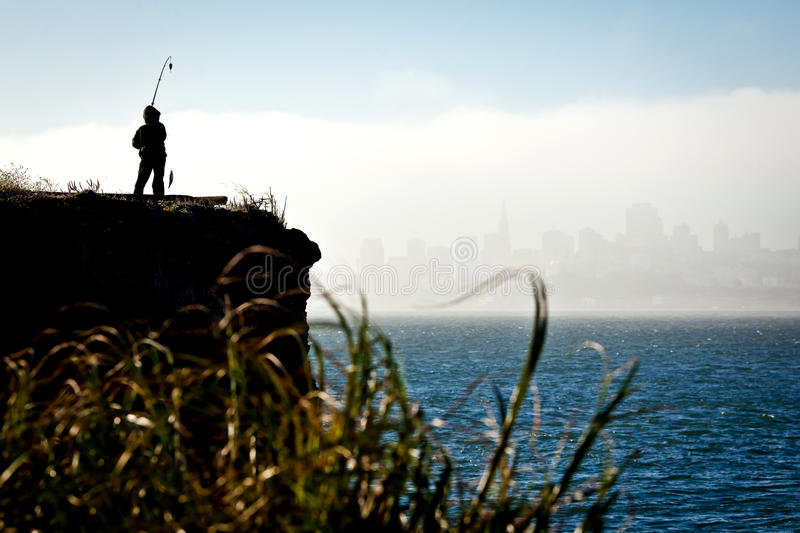 Silhouette Of A Fisherman In San Francisco Stock Images