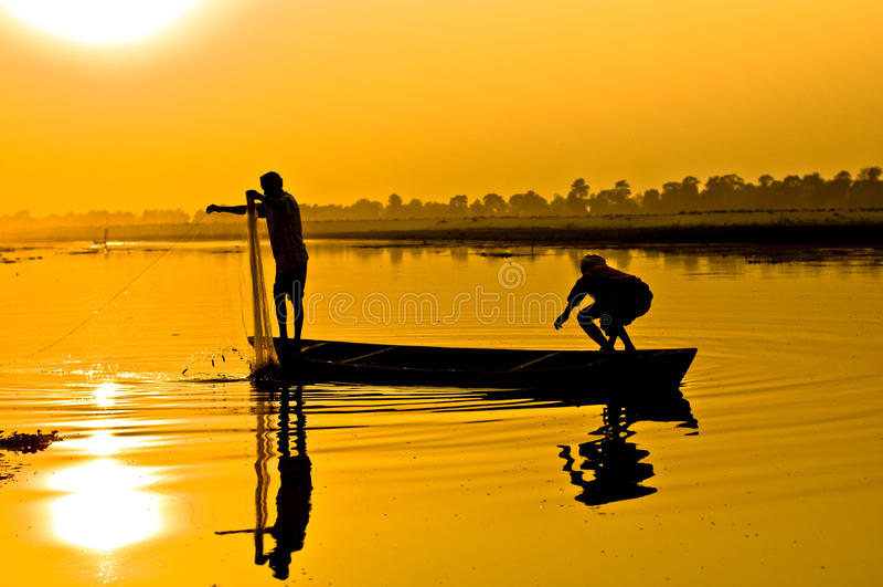 Silhouette: Fishermen royalty free stock photo