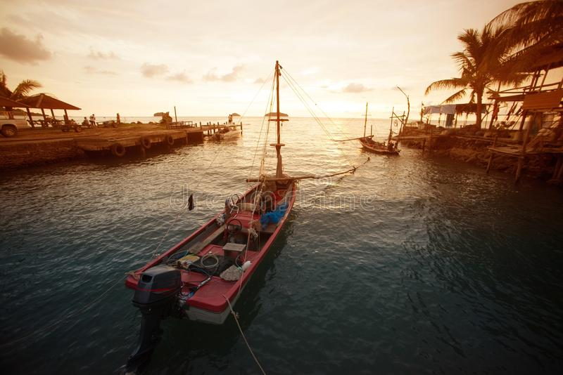 Silhouette fishing boat on the sea ,Thailand. stock photos