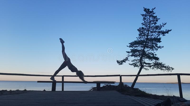 Fit caucasian woman practicing yoga outside royalty free stock photography