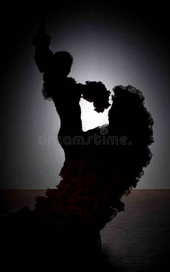 Silhouette of flamenco dancer. In dress on dark background royalty free stock photography