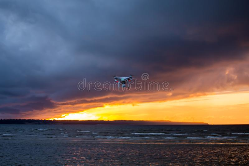 Flying drone over sea and cloud sky royalty free stock photography