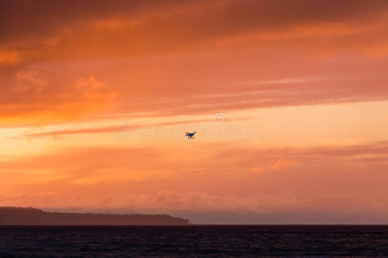 Flying drone over sea and cloud sky royalty free stock photo