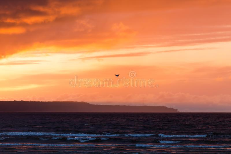 Flying drone over sea and cloud sky stock photo