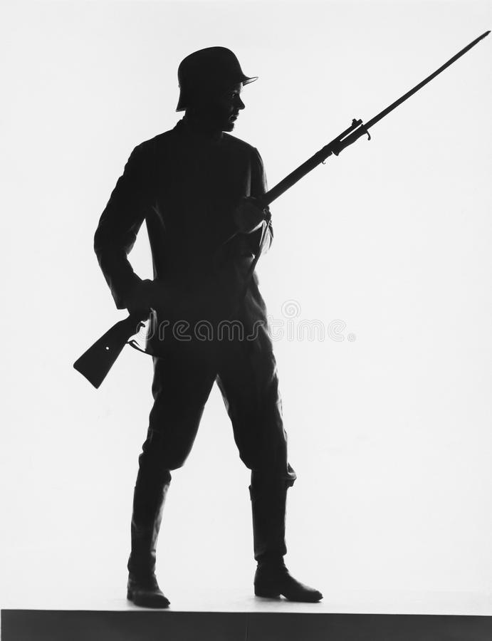 Silhouette of foot soldier, circa World War I stock photo