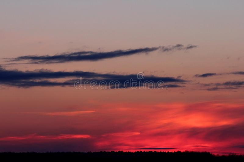 Sunset sky with dramatic clouds stock photo