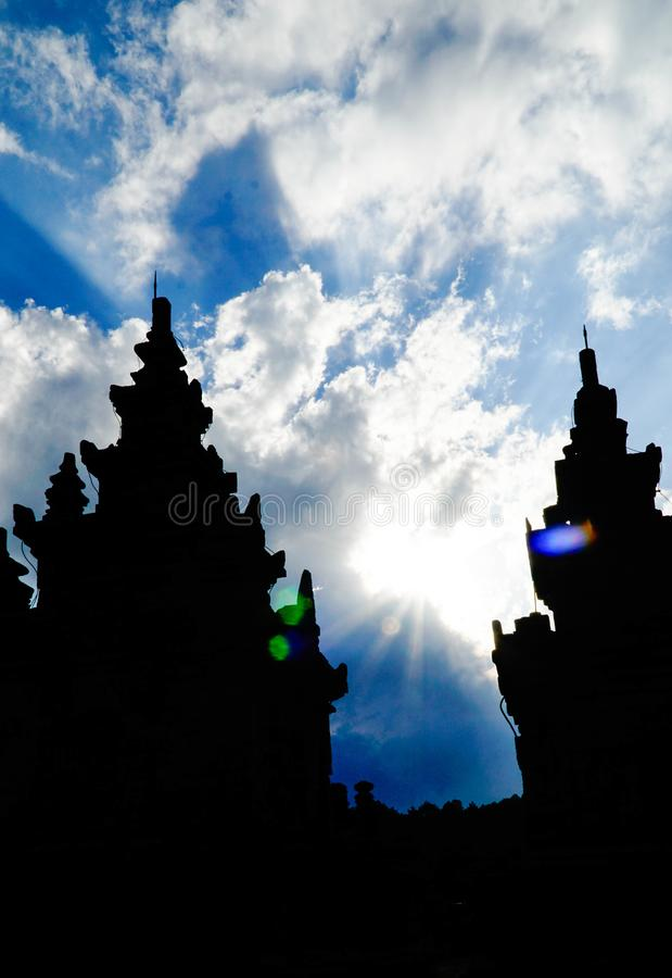 Silhouette of Gedong Songo Temple, Semarang, Indonesia. The sunlight behind the white clouds above the Gedong Songo Temple, Semarang, Indonesia stock image