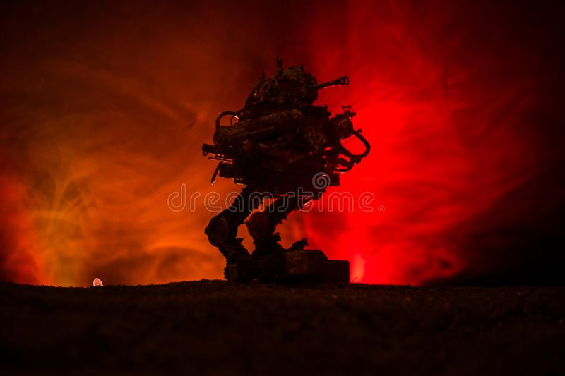Silhouette of Giant robot. Futuristic tank in action with foggy fire sky background stock photography