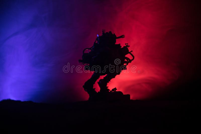 Silhouette of Giant robot. Futuristic tank in action with foggy fire sky background royalty free stock photography