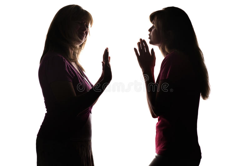 Silhouette girl begging the parent to allow something, but gets refused. Silhouette on white isolated background mother and daughter dialog, adolescent begging royalty free stock photography