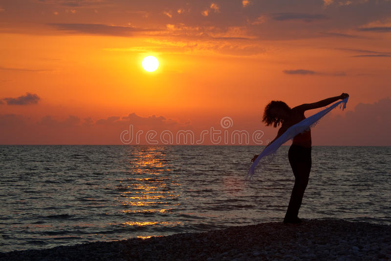 Download Silhouette Of Girl With Handkerchief At Sunset Stock Image - Image: 13301077