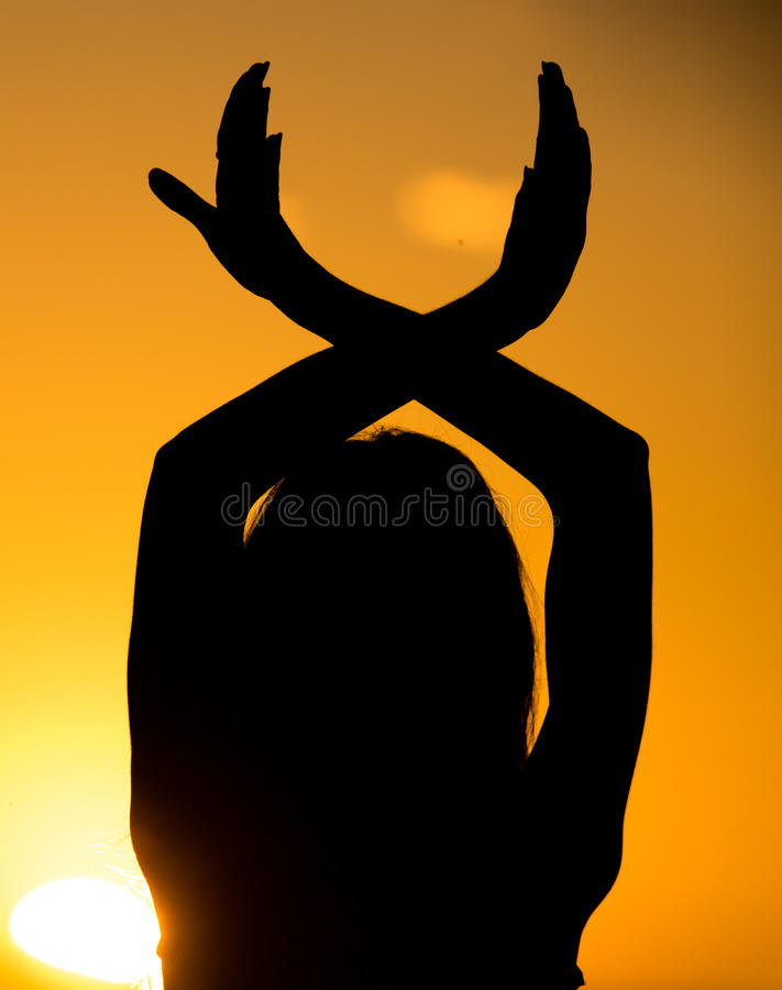 Silhouette of a girl's hand on a beautiful sunset royalty free stock photos