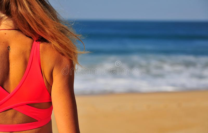 Silhouette of a girl on the beach. Silhouette of a girl on the sand beach royalty free stock photography