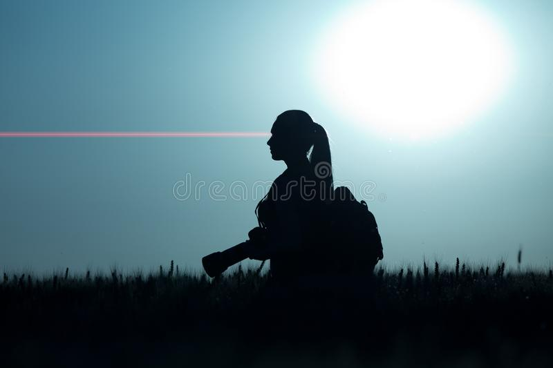 Silhouette of girl shooting in nature stock photography