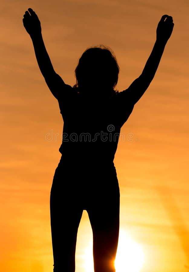Silhouette of a girl in the sunset royalty free stock image